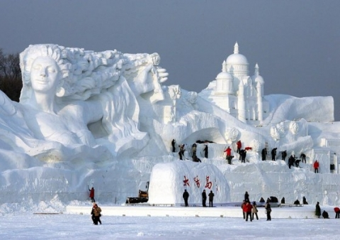 """""""Romantic Feelings"""", the world's largest snow sculpture, was constructed in Heilongjiang Province, China. The centerpiece stretched the staggering 656 ft long and 115 ft tall."""