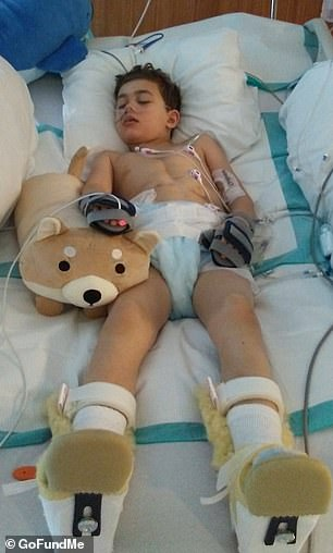 Jace currently can't talk or move his arms or head, but he can kick his legs, move his eyes and smile. Pictured: Jace in the hospital