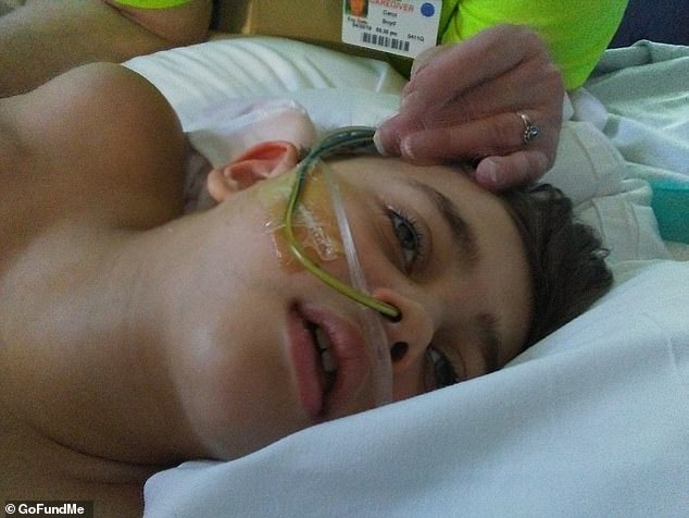 Because he was without oxygenated blood for up to 20 minutes, he's suffered brain damage that surgeons believe is permanent. Pictured: Jace in the hospital