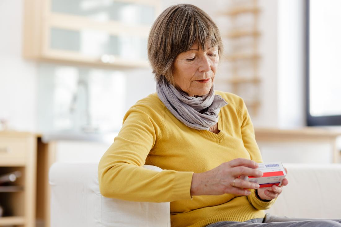 senior lady reading medicine packet