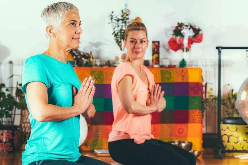 senior-woman-on-private-yoga-class