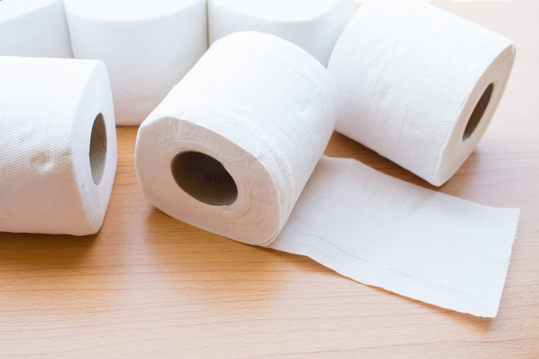 Toilet rolls on wooden table for black poop