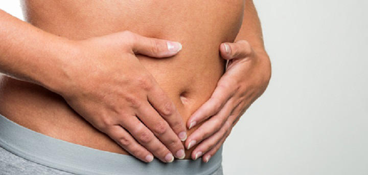 person holding stomach and colon