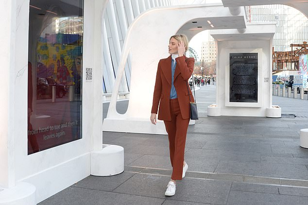 Martha Hunt, 30, has lived with chronic pain for her entire adult life and wants to raise awareness about the 'invisible disease.' Pictured: Hunt, walking through an exhibition at the Oculus in New York in December for This Is Pain, an advocacy group she is involved with