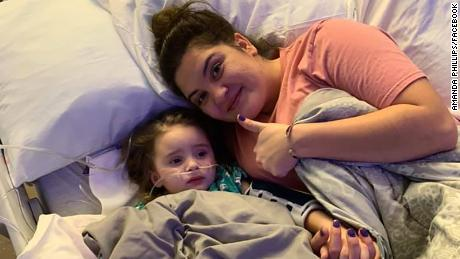 Jade DeLucia, with her mother Amanda Phillips, after regaining consciousness.