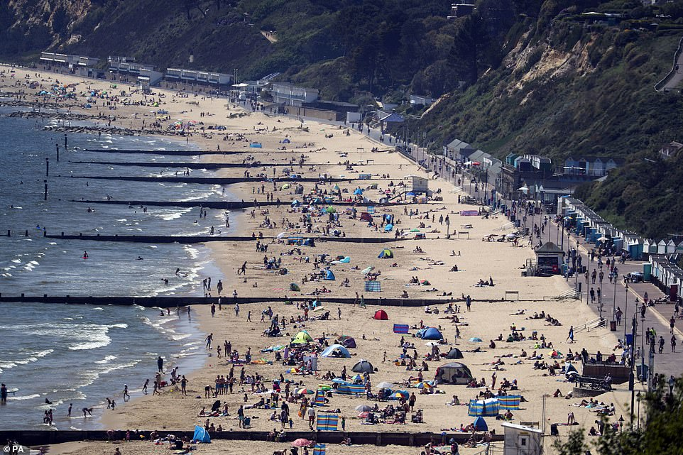 An aerial view of hundreds of people on the beach in Bournemouth today, as many took advantage of lockdown restrictions being loosened to allow sunbathing