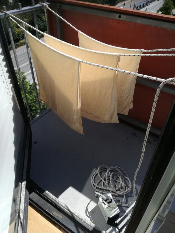 The experimental setup of towels, hanging on a balcony at the University of Copenhagen.