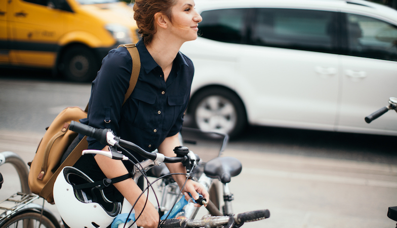 woman-locking-bike-cycle-plan-made-easy-by-healthista.com-slide.jpg